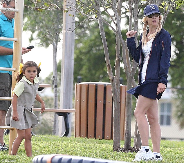 Tiger's kids: Elin Nordegren took her kids Sam and Charlie to play in a Florida park today