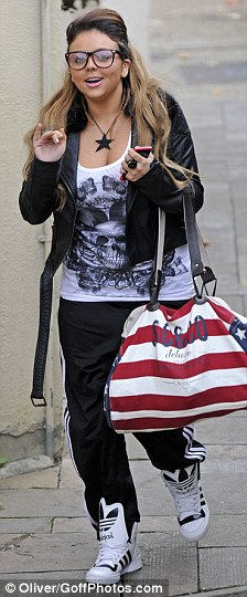 Feeling happier: A smiley Jesy arrived at rehearsals for this weekend's live show and beamed for the cameras