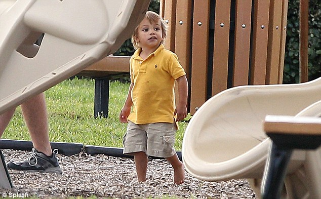 Adorable! Elin and Tiger's son Charlie looked like a ray of sunshine in his little yellow polo shirt