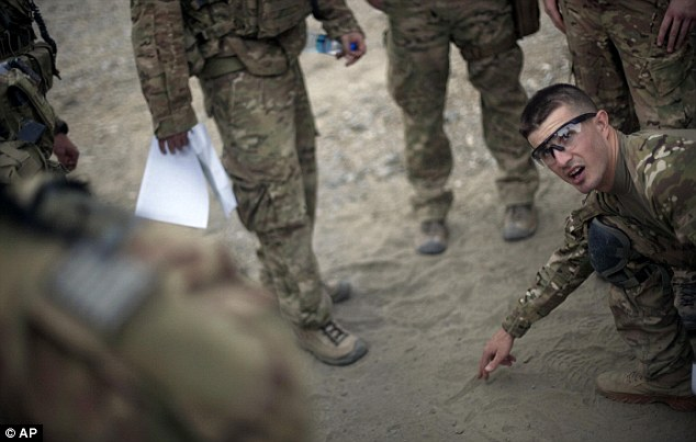 Drawing battle lines: Andrew Ferrara holds a pre-briefing before a mission