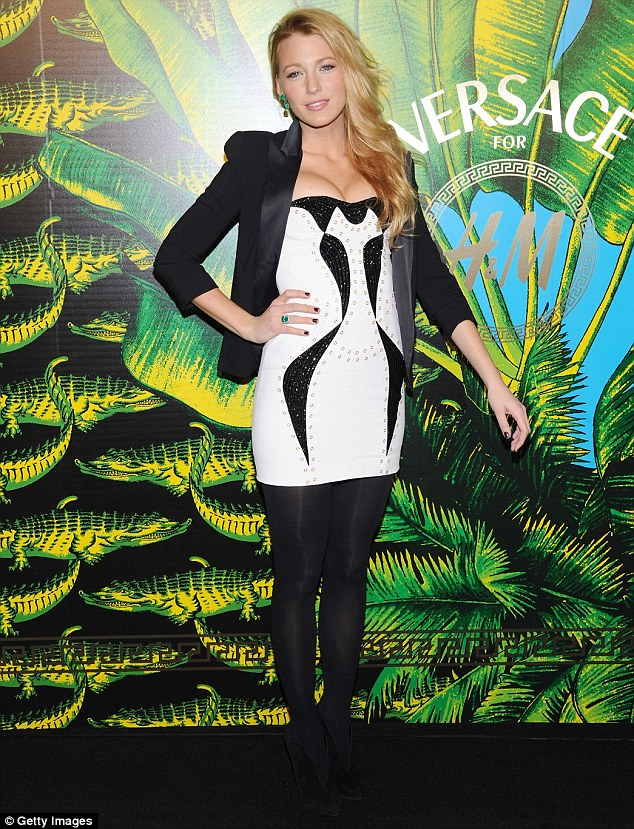 Dangerous curves: Blake Lively slipped into a daring low-cut dress which struggled to contain her ample assets at the Versace for H&M Fashion event in New York tonight