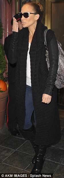The singer showed off her slim pins yesterday in a pair of sung jeans with black knee-high boots.