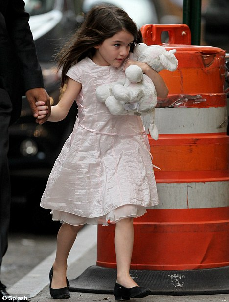 Girl about town: Suri looked cute in a pink dress and black shoes