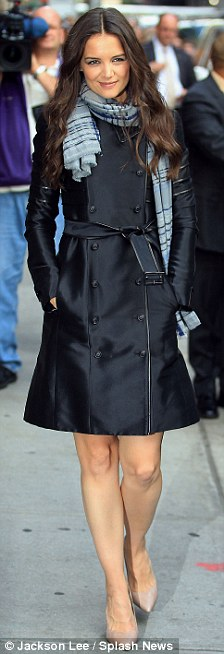 Stylish: Katie had transformed from her earlier drab appearance, donning a black leather coat