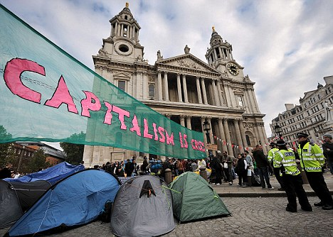 Embarrassment: A firearms officer is facing disciplinary action after waking up in a protester's tent outside St Paul's last week following a night of heavy drinking