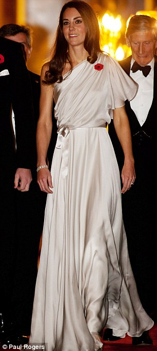 The Duchess wore a Temperley creation which skimmed over one shoulder and tied around the waist. Her height and slim figure carried off the graceful Grecian style dress which were coupled with shoes of the same colour