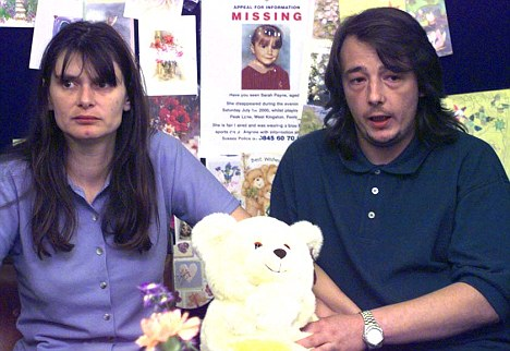 Michael Payne (right) with his ex-wife Sara during an appeal for their missing daughter in 2000
