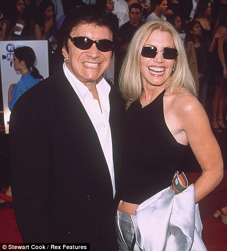 All made up: Gene Simmons with his wife Shannon. Over four decades he has built up a multi-million-pound empire