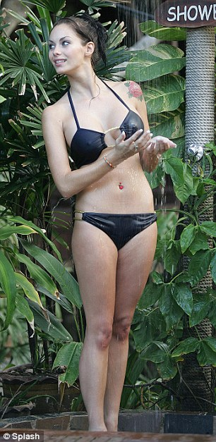 Perfecting her Myleene moves: The 26-year-old already looks at home beneath a waterfall shower