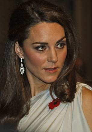 The Duchess looks glamorous in her Grecian style dress, coupled with the all important poppy. She also adds some sparkle with some heavy looking earrings