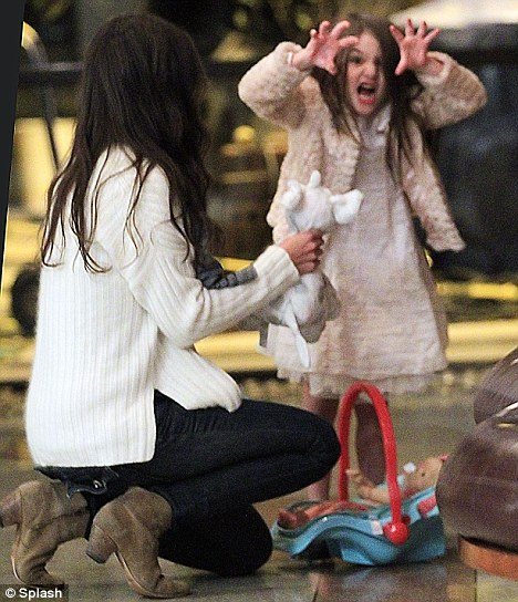 I'm a Hollywood child, hear me roar: Suri makes a lion's face at the photographers