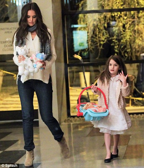 Sharing the load: Katie carried Suri's cuddly toys while the little girl took charge of her baby doll