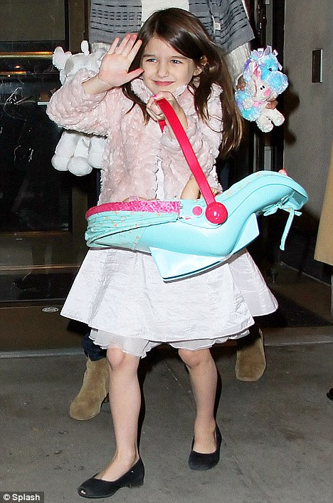 Greeting her adoring public: Suri waves as she leaves the hotel with her mother
