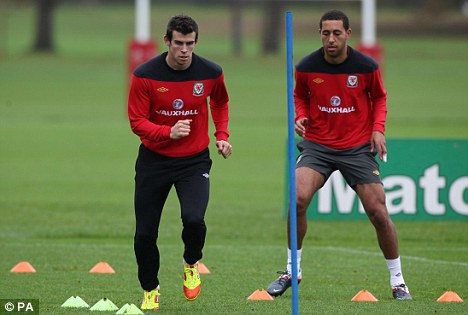 Enter the dragon: Bale training with Wales earlier this week