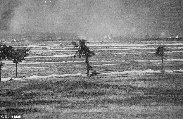 War zone: Explosions and smoke are seen in the distance at the Battle of Loos, where Barnard was killed in 1915