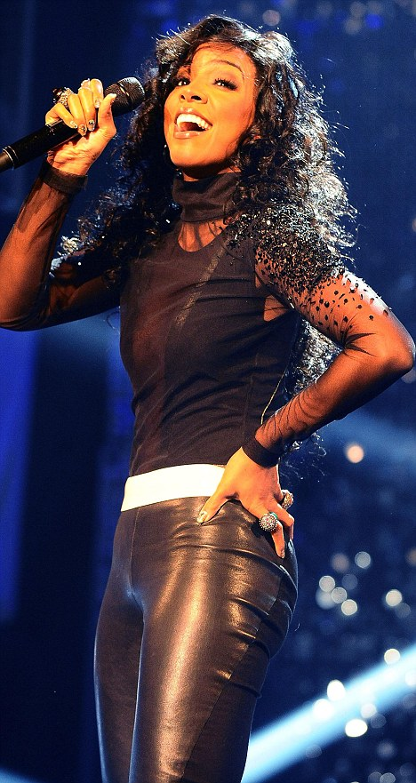 Back to work: Kelly Rowland looks stunning as she performs during the filming of the Graham Norton Show
