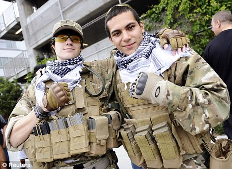 Hardcore: Players of the game, such as Matt Lack, left, and Nick De La Torre, who dressed in mock military uniforms for the premiere, are known to be fanatical