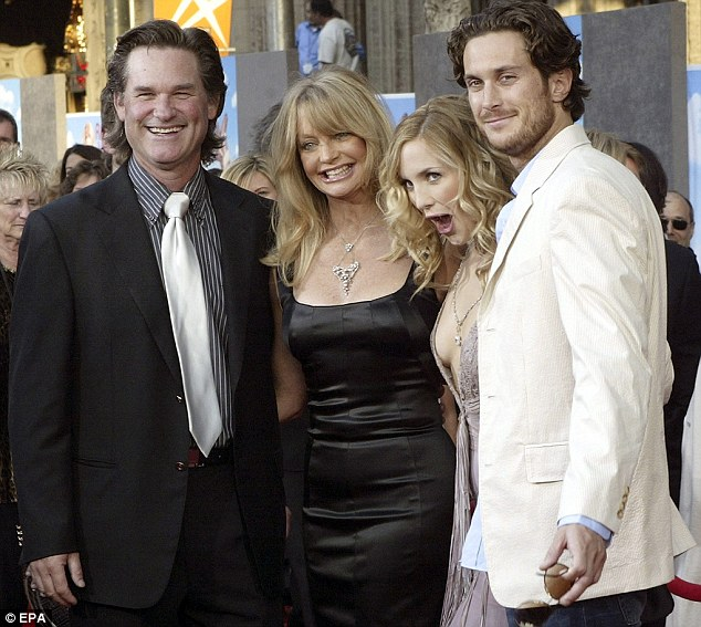 Happy family: Goldie Hawn with actor Kurt Russell, left, and Kate and Oliver Hudson
