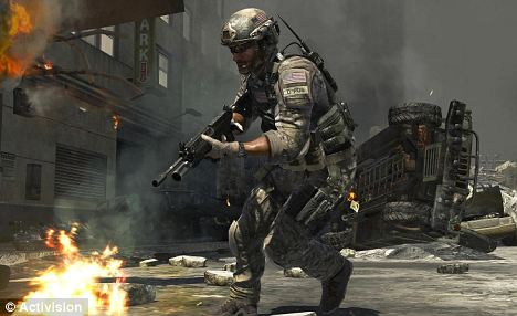A real blast: 'Call of Duty: Modern Warfare 3' set a first-day sales record by generating $400million in sales in its first 24 hours in stores