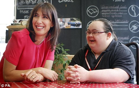Good news: Samantha Cameron chats with Paula Sage, who has Down's syndrome, during a visit earlier this year to Glasgow. Scientists in America have made a breakthrough which could lead to the condition becoming extinct
