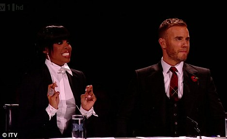 Fingers crossed: The judges apparently didn't know who had won the vote before it was announced