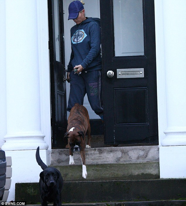 Stepping out: Zara Phillips coming out of the couple's home to take her dogs for a walk yesterday morning