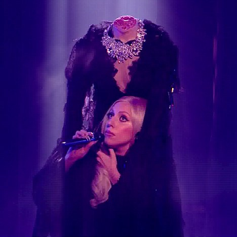 Losing her head: The singer wore a suit that made it appear as though she'd been decapitated for her X Factor performance