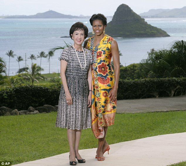Warm welcome: Michelle Obama pictured greeting Fang-Yui Lien, spouse of the Representative of Chinese Taipei, before the APEC Spousal Luncheon