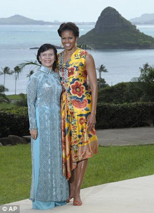 First lady Michelle Obama greets Madam Mai Thi Hanh, the first lady of Vietnam, before the APEC Spousal Luncheon at Kualoa Ranch