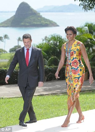 US First Lady Michelle Obama (R) walks with new White House social secretary, Jeremy Bernard (L), as she hosts the APEC