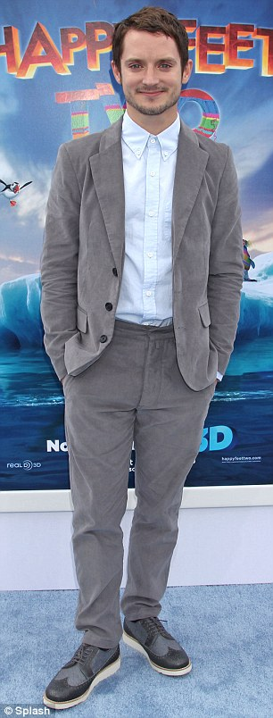 Male stars: Elijah Wood and rapper Common, who also provide voiceovers for the film, dressed smart casual for the occasion