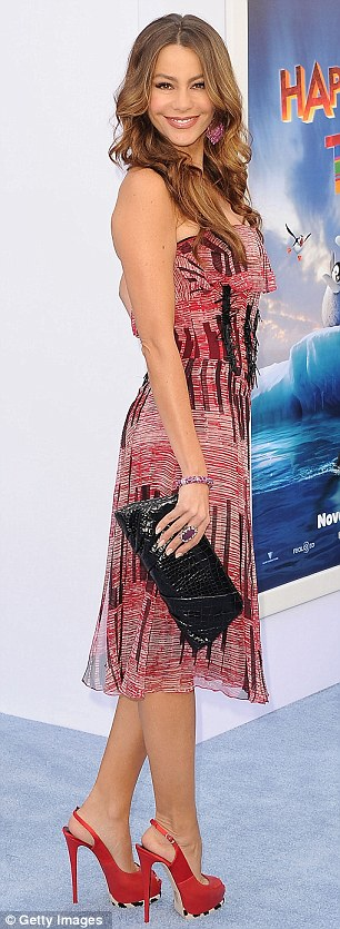 Ravishing in red: Despite the wintery theme Modern Family actress Sophia Vergara put on a summery display by showing off her curves in a red and black patterned strapless dress