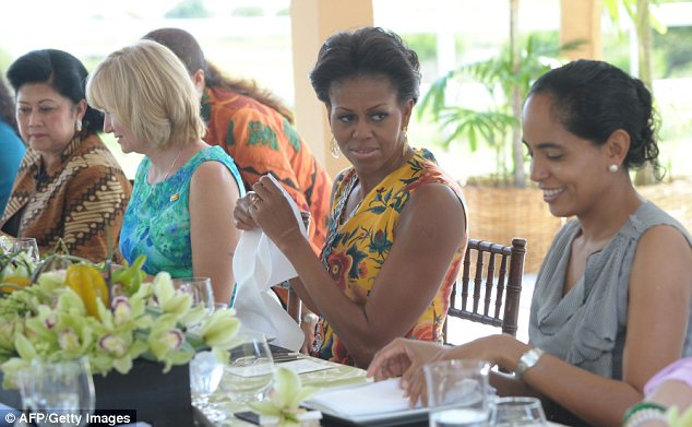 Tucking in: Michelle Obama sits with the spouses of APEC leaders during the luncheon