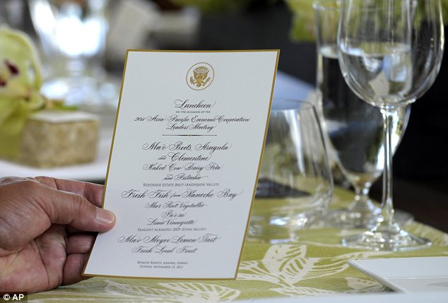 Browsing: Tim Mathieson, partner of Australian Prime Minister Julia Gillard, looks over a copy of the menu at the luncheon
