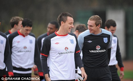 Ongoing: Chelsea captain John Terry (centre) is involved in his own race row