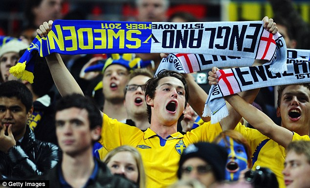 Happy to be here: Sweden fans cheer inside Wembley