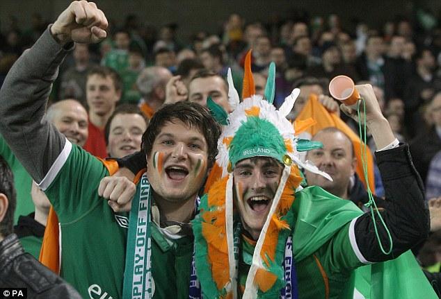 Celebrate good times: Irish fans pose for the cameras inside the Aviva Stadium