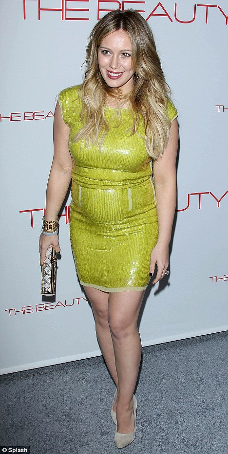 Expecting: Hilary Duff wears unusual maternity dress as she attends launch of The Beauty Book in Hollywood