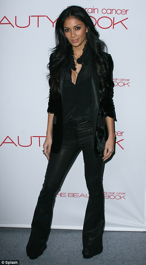 Biker chic: Nicole Scherzinger channelled her inner rock chick as she dressed entirely in black