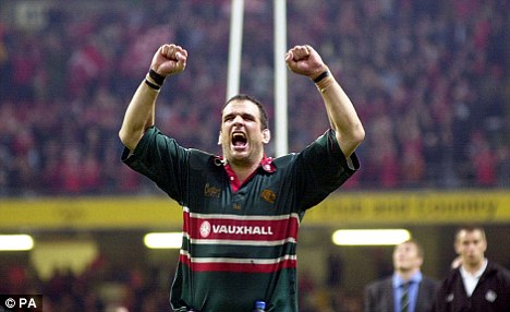 Serial winner: Johnson hails his second Heineken Cup victory with Leicester in 2002