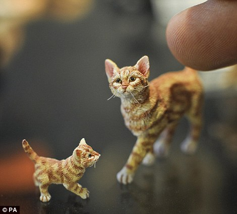 Tiny hairs cover the coats of these one-twelfth scale cat and kitten made by Sarah Hendry