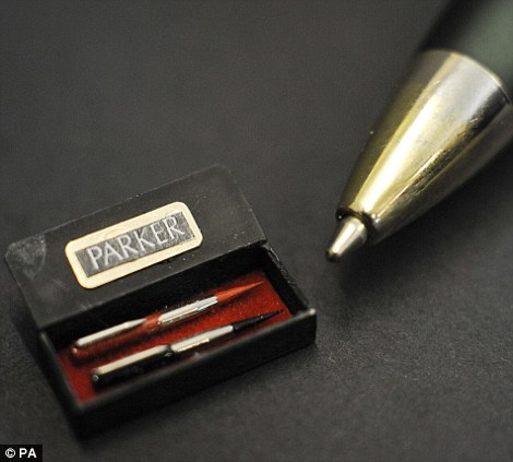 A box of two Parker pens, costing £9, made by Klaas Schultz of South Africa are dwarfed by the nib of a ballpoint pen