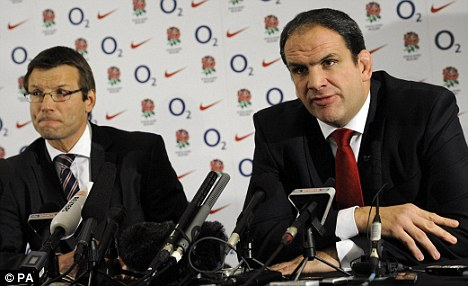 Taking it in his stride: Johnson prepares to resign, with Rob Andrew behind and below during the press conference