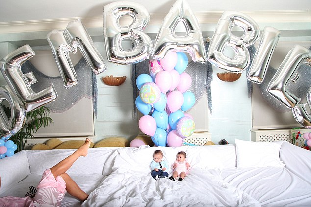 Spoilt rotten: Mariah Carey's twins Moroccan, left, and Monroe sit on a huge white couch in a room decorated with balloons, including some inflated letters reading their nickname Dembabies