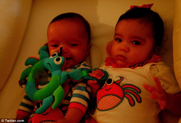 Bed time: The brother and sister snuggled together in their cot