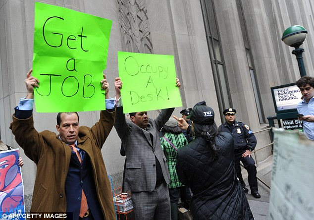 Different opinions: But Derrick Tabacco, left, a small business owner, joined a small group counter-demonstrating against the Occupy Wall Street march near the New York Stock Exchange yesterday