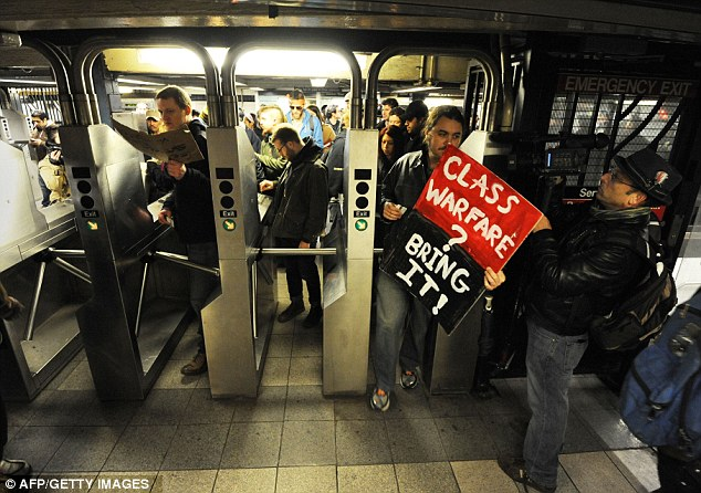Turnstiles: Demonstrators with Occupy Wall Street enter the subway as part of their protests