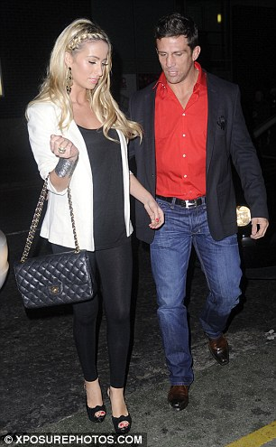 You could have made an effort, you two! Chantelle Houghton and Alex Reid arrive and stood out from the glitz and glamour in their casual attire