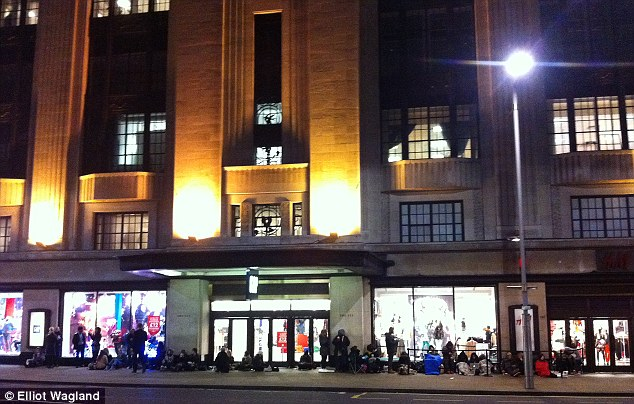 Shoppers pictured in the early hours of the morning camping outside H&M in High Street Kensington as Versace's cut-price collection hits the high street today
