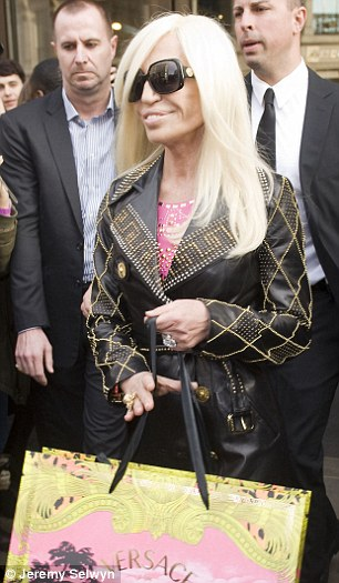 Donatella wore a pink leather studded dress, which she had taken in to make it a tighter fit, and a leather jacket, both from the collection
